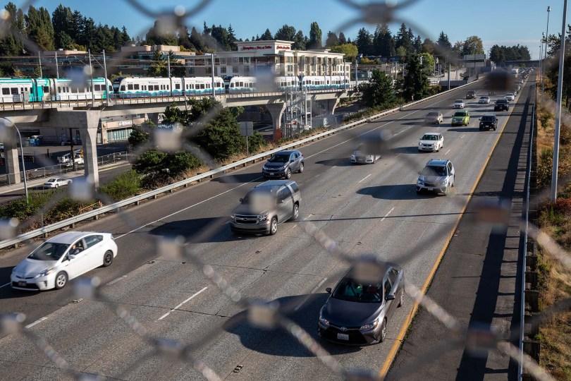 Photo depicting the northbound I-5 highway running alongside the Northgate light rail station.