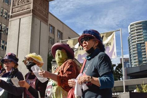 Photo depicting members of Raging Grannies singing songs.
