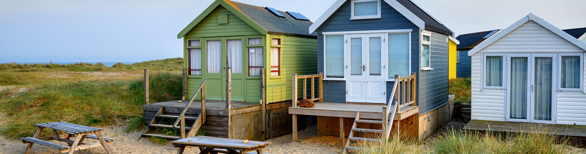 Beach huts on Mudeford Spit a narrow strip of sand between Hengistbury head and Mudeford at Christchurch in Dorset
