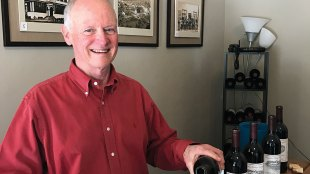 Paradise valley owner Claude Solanas pouring at Hiram Morgan Hill House
