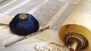 torah scroll, yad, blue kippa on tallit