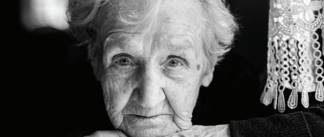 senior woman staring a camera: b/w photo