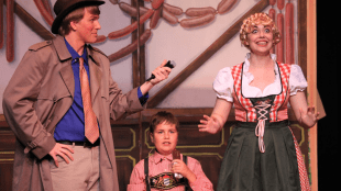 GREEDY GLOOP Roald Dahl's Willy Wonka is now playing at Morgan Hill South Valley Civic Theatre through July 15. Newsman Phineous Trout (Zack Goller) interviews Augustus Gloop (Josh Watts) and his mom upon winning the golden ticket.