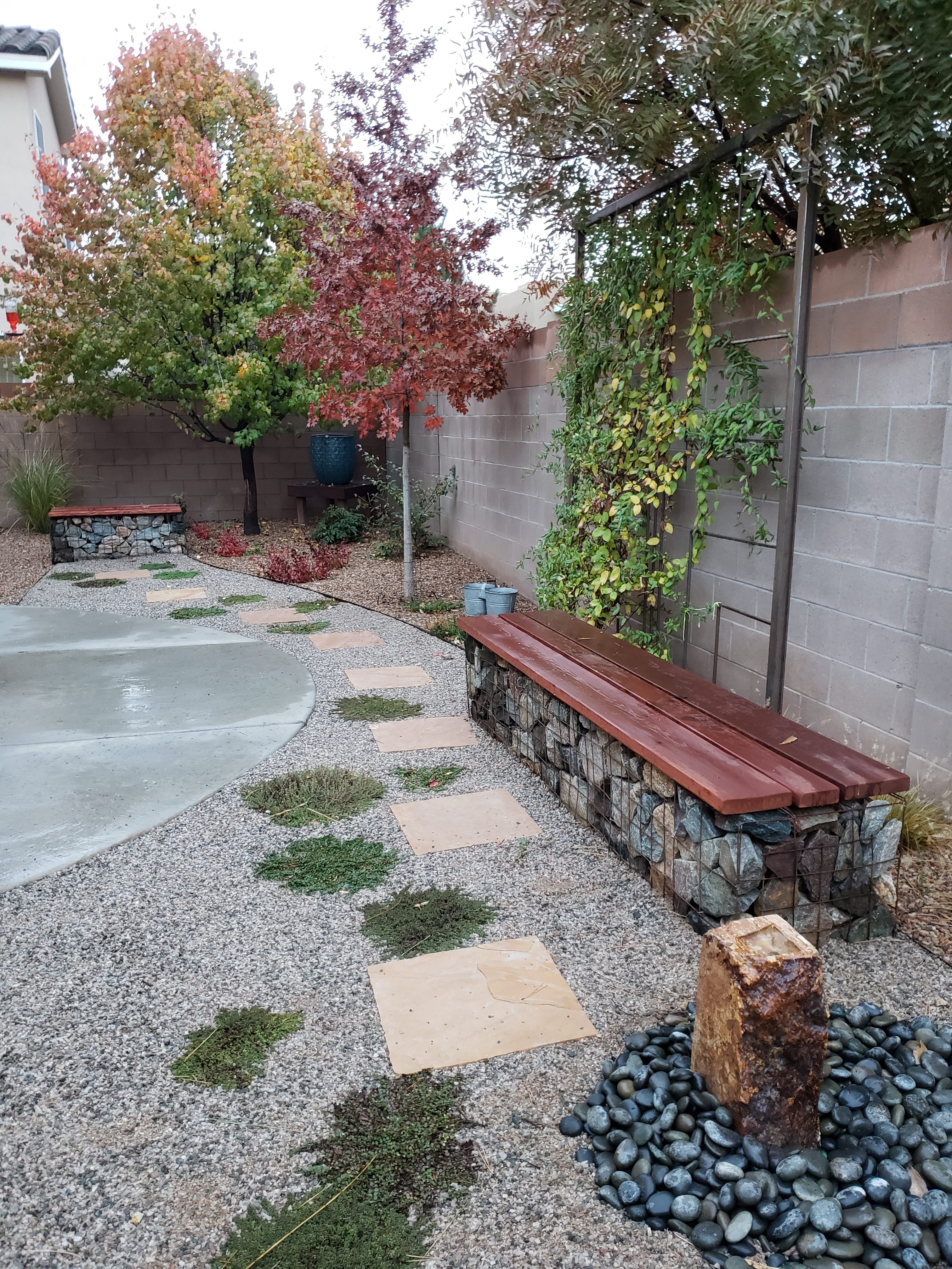 Landscaping in Albuquerque, NM Xeriscape rebate conversion, water feature, gabion wall, bench, native plants