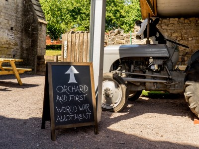 Sign and tractor