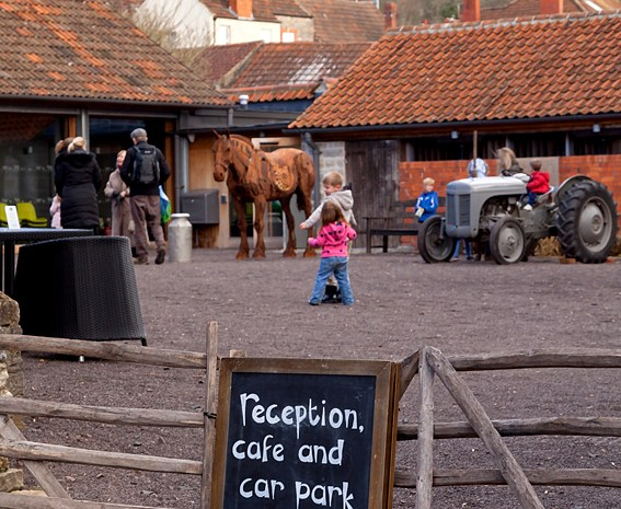 A-board with sign to reception and cafe with Somerset Rural Life Museum in the background