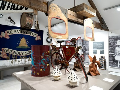A flag, bike, barrel and a display of otherbjects at Somerset Rural Life Museum