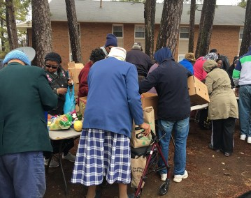 Community members help themselves to what they need.