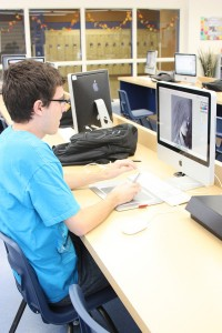 Senior Jacob Race uses a Bamboo Drawing Tablet to create graphics for his Web Design class.<br/>Photo Credit: Alex Nedelcu