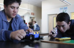 Sophomore Kristian Campanella and junior Joseph Alutro work together to finish the physics challenge.Photo Credit: Jacob Berroya