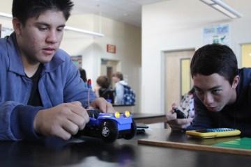 Sophomore Kristian Campanella and junior Joseph Alutro work together to finish the physics challenge.Photo Credit: Jacob Berroya