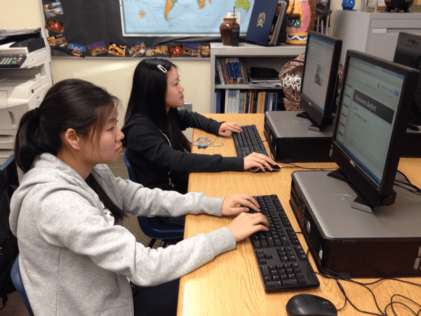 "Sophomores Samantha-Juliane Lam and Maggie Gee research their destination to compose a trip itinerary for a three day vacation. They plan to travel to Reno, NV. ""I really like my itinerary. I kind of want to go to Reno and follow it now,"" Lam said.  Photo Credit: Jen Chiang"