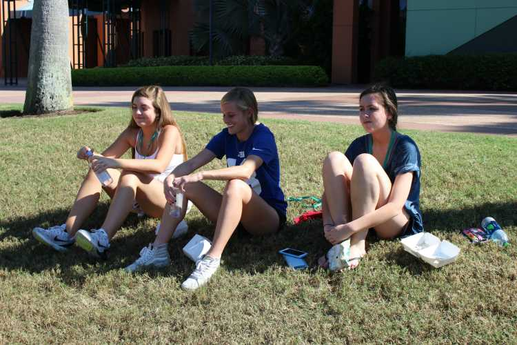 Taking a break in the grass are juniors Chloe Keating, Adeline Beattie and Frankie Sammartano from Kirkwood High School. The girls decided to spend a minute chilling out in the shade.