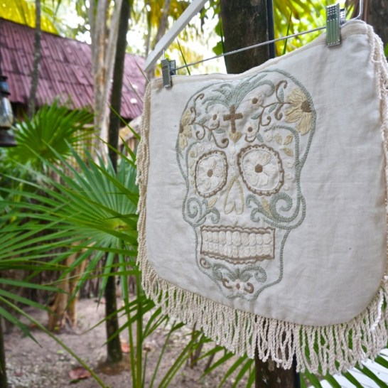 This playful skull throw pillow case would make a great conversation piece. From La Troupe, Tulum.