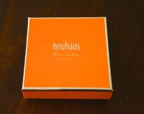 Neuhaus' signature orange gift box.