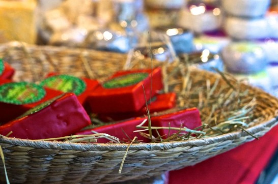 Soaps packaged in festive red and green wrappings.