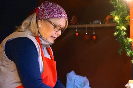 A vendor at work at the Kungstradgården Christmas market.