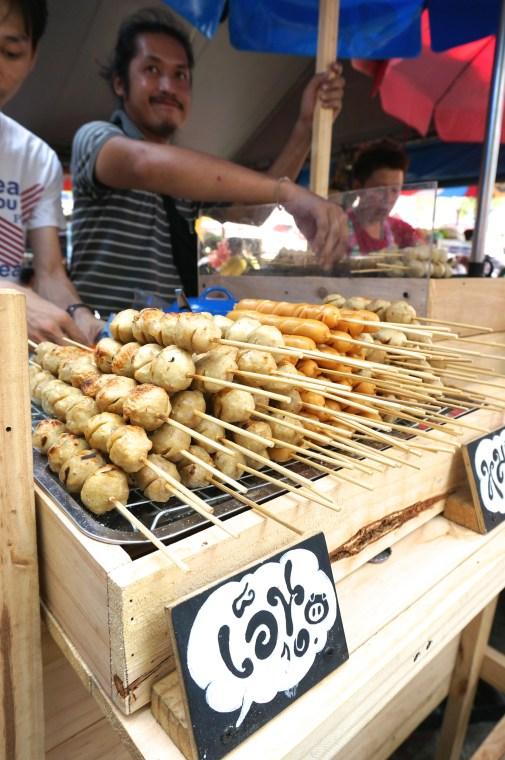 look chin (beef, chicken and pork balls on a stick) bangkok Thailand Chatuchak market street food vendors