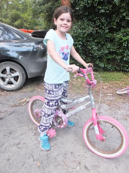 Alannah also gives us an action shot, ready to take off on a bike ride.