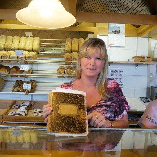 The daughter of the oldest baker in Alesund shows us the original recipe book.