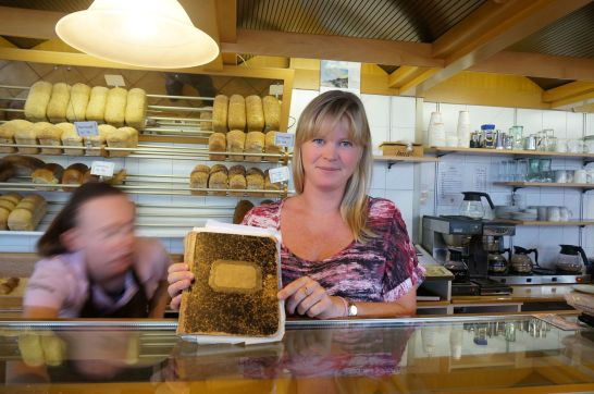 The owner's grand daughter shows off the original recipe book.
