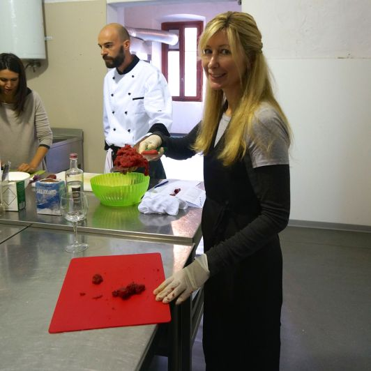 splendid tee worn under dress in cooking class in Bergamo, Italy.
