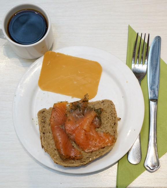 This is what brunost looks like when sliced thin (with a Norwegian cheese slicer, natch).