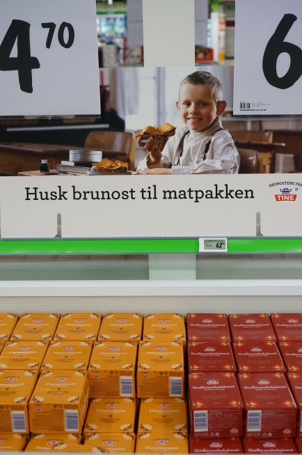A display case of brunost at a Norwegian grocery store.