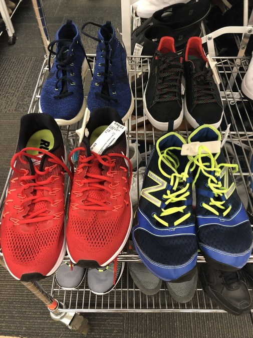 Piles of sneakers at unclaimed baggage store.