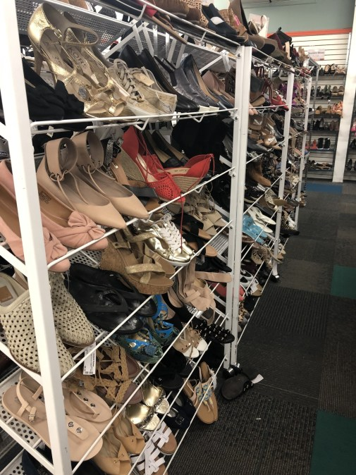 Rows of shoes at Unclaimed Baggage Store.