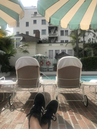 chateau marmont pool deck chairs outdoors