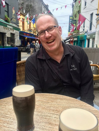 """At an outside table in Galway, just after getting scolded by the barkeep for taking my Guinness before it was """"ready."""" It's a two-stage pour in Ireland. I guess I'm a tourist."""