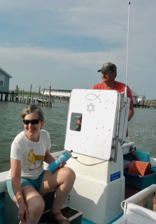 Ookire at the helm of his Chesapeake Bay deadrise (crab boat)