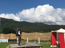 Bagpiper competing, Cairngorms in background