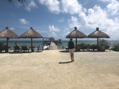 Souzz heads out onto the dock to enjoy her first beer on Caye Caulker