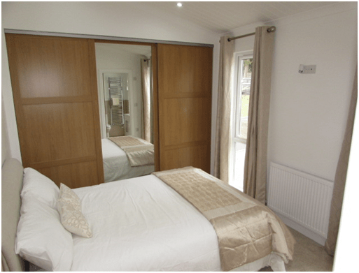 The Meadow Wood - Park Home - Interior photo of luxury bedroom with furnishings
