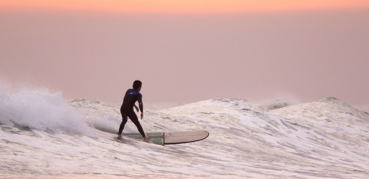Surfer on his board