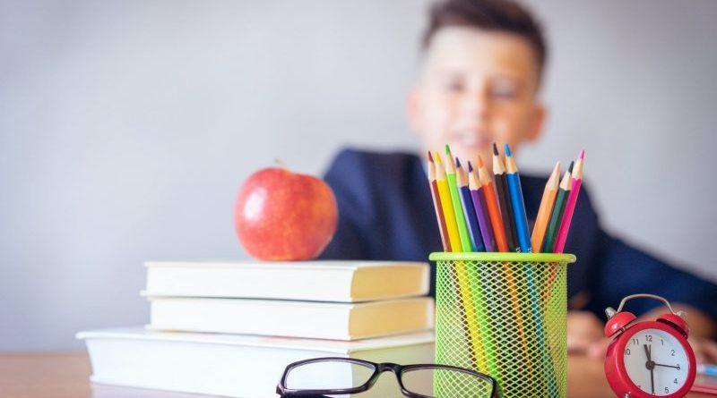 boy looking on a tidied desk