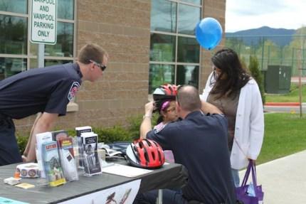 Bike helmet safety checks at 2012 Healthy Kids Day