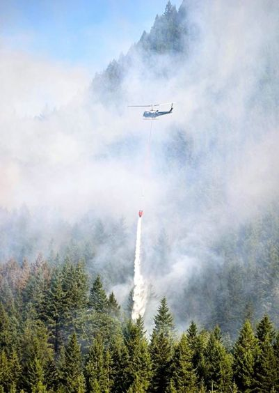 DNR helicopter performs water drop on Mt Si fire on 7/26/13. Photo by Aviv Stern