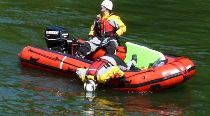 Rescue crews search Snoqualmie River for truck that was reported going into river overnight, 4/27/14.  Photo: Liz Lawrence