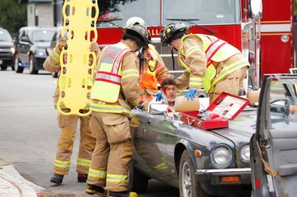 Firefighters work at MSHS mock crash, 6/4/14. Photo: CIty of Snoqualmie