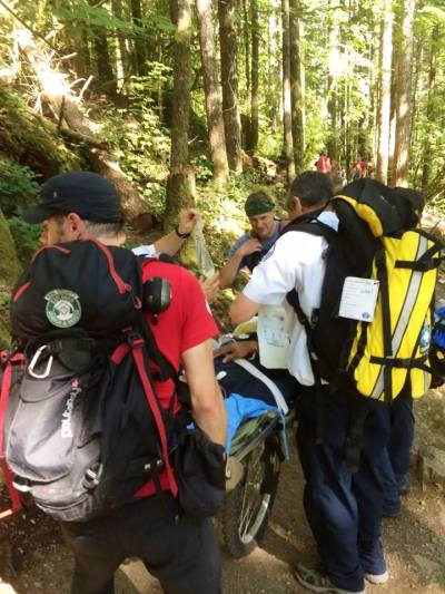 Search and Rescue Crews help hiker with medical emergency off Rattlesnake Ledge. Pic: Facebook