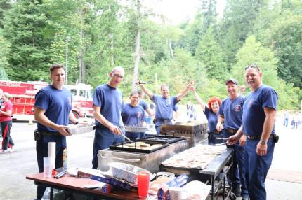Snoqualmie Firefighters cook breakfast at the 2014 Pancake Breakfast at the Fire Station. Photo: City of Snoqualmie