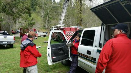 SAR crews on scene in the Rattlesnake Trailhead area of North Bend to assist a woman with a broken leg off the trail, 4/4/16