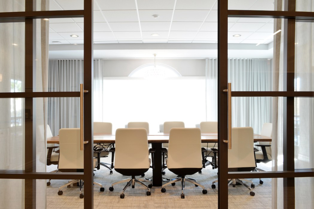 Glass conference room in interior design for financial firm office by Space as Art Tampa Sarasota Venice interior designer