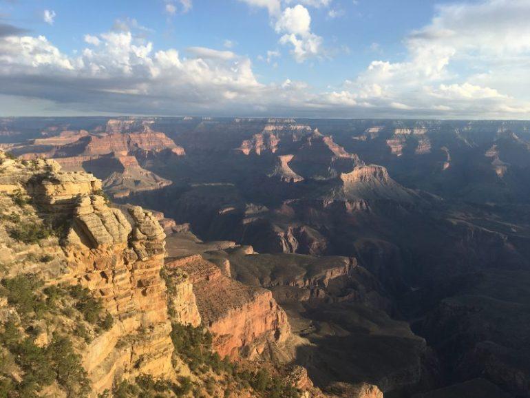 The sunrise splashes bright light onto the Grand Canyon walls