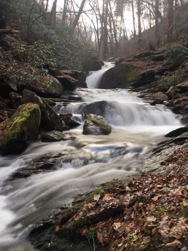 Beautiful creek of small waterfalls tumbling downhill