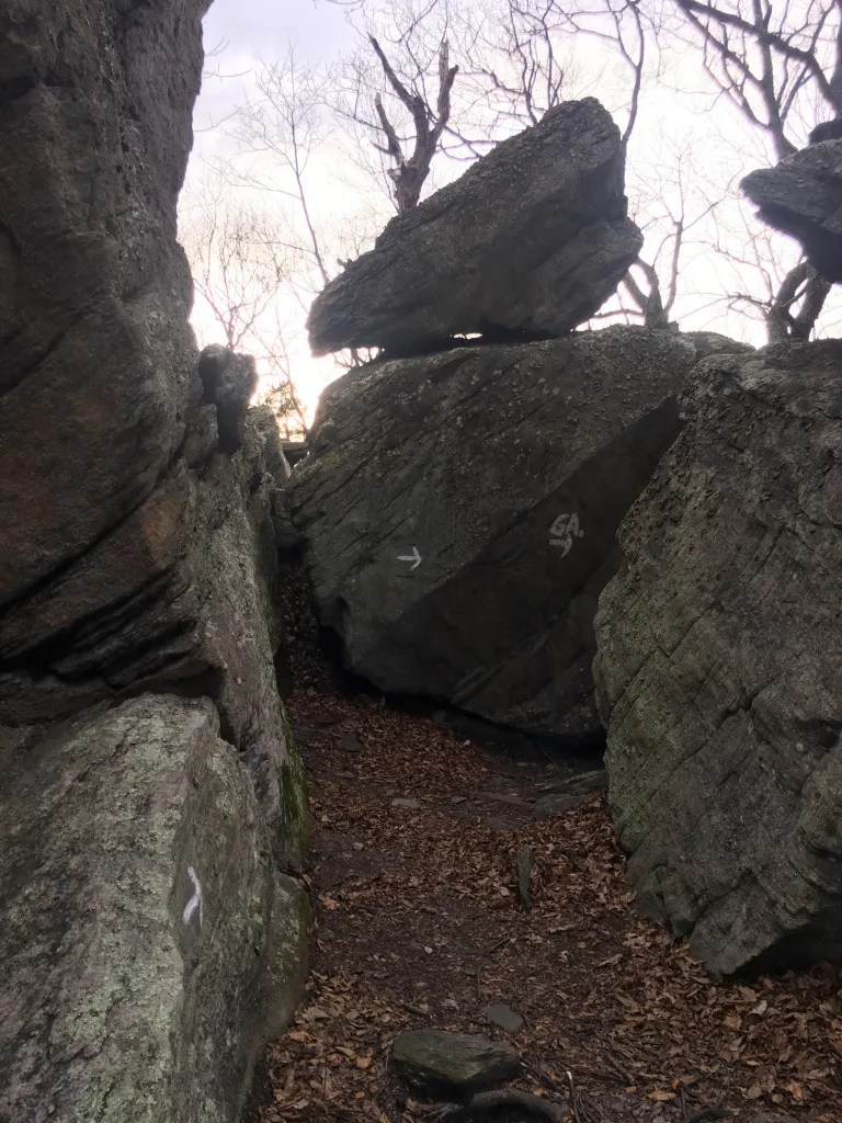 White painted arrows designate the Georgia bound path through a pile of large boulders.