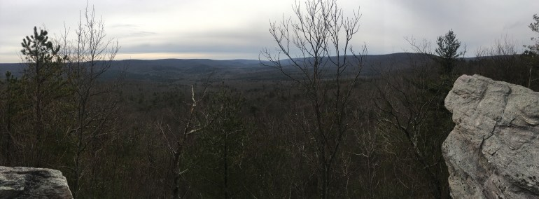 Panoramic winter view from a rocky outcrop